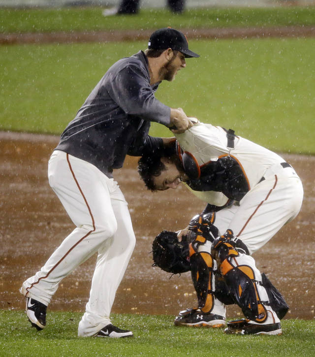 San Francisco Giants catcher Buster Posey and pitcher Madison Bumgarner, left, celebrate after the Giants beat the St. Louis Cardinals 9-0 after Game 7 of baseball's National League championship series Monday, Oct. 22, 2012, in San Francisco. (AP Photo/Mark Humphrey)