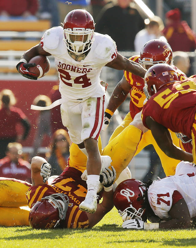 Oklahoma's Brennan Clay (24) carries the ball in the fourth quarter during a college football game between the University of Oklahoma (OU) and Iowa State University (ISU) at Jack Trice Stadium in Ames, Iowa, Saturday, Nov. 3, 2012. OU won, 35-20. Photo by Nate Billings, The Oklahoman