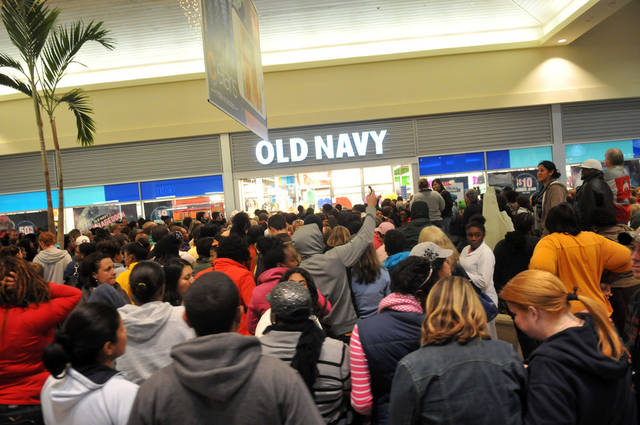 A large crowd of shoppers waits outside an Old Navy store just after midnight during Black Friday shopping at Oglethorpe Mall in Savannah, Ga. on Friday, Nov. 23, 2012. (AP Photo/The Morning News, Richard Burkhart) THE EXAMINER.COM OUT; SFEXAMINER.COM OUT; WASHINGTONEXAMINER.COM OUT