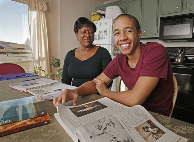 Dawn Johnson homeschools son Jordan, 16, at the kitchen table on Thursday, Jan. 12, 2012, in Norman, Okla.  Both are covered by federal temporary high risk pool health insurance. Photo by Steve Sisney, The Oklahoman