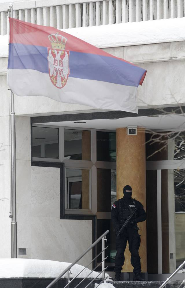 A member of the Serbian Gendarmerie guards the entrance to a high-security prison in Belgrade, Serbia, Tuesday, Feb. 7, 2012. Serbian authorities stepped up security at a high-security prison Tuesday after a dangerous prison inmate jailed for his role in the assassination of a prime minister tried to break out with another high-profile convict. (AP Photo/Darko Vojinovic)