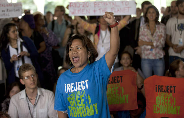 Environmental activists chant slogans while blocking a corridor inside the venue hosting the United Nations Conference on Sustainable Development, or Rio+20, in Rio de Janeiro, Brazil, Thursday, June 21, 2012. (AP Photo/Victor R. Caivano)
