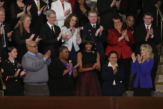 First lady Michelle Obama is applauded before President Barack Obama's State of the Union address during a joint session of Congress on Capitol Hill in Washington, Tuesday Feb. 12, 2013. Front row, from left are, Sgt. Sheena Adams, Nathaniel Pendelton, Cleopatra Cowley-Pendelton, Mrs. Obama, Menchu Sanchez and Jill Biden. (AP Photo/J. Scott Applewhite) ORG XMIT: CAP117