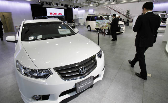Honda cars are displayed at a showroom at the headquarters of Honda Motor Co. in Tokyo Friday, April 27, 2012. Honda's January-March profit jumped 61 percent as the Japanese automaker sold more cars and motorcycles in a turnaround from a disaster-battered 2011. It forecast record global sales of 4.3 million vehicles for this fiscal year. (AP Photo/Koji Sasahara)