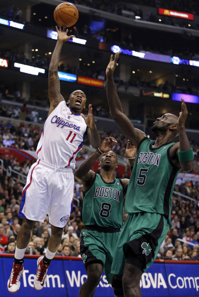 Los Angeles Clippers' Jamal Crawford, left, puts up a shot as Boston Celtics' Jeff Green, center, and Kevin Garnett watch in the first half of an NBA basketball game in Los Angeles, Thursday, Dec. 27, 2012. (AP Photo/Jae C. Hong)