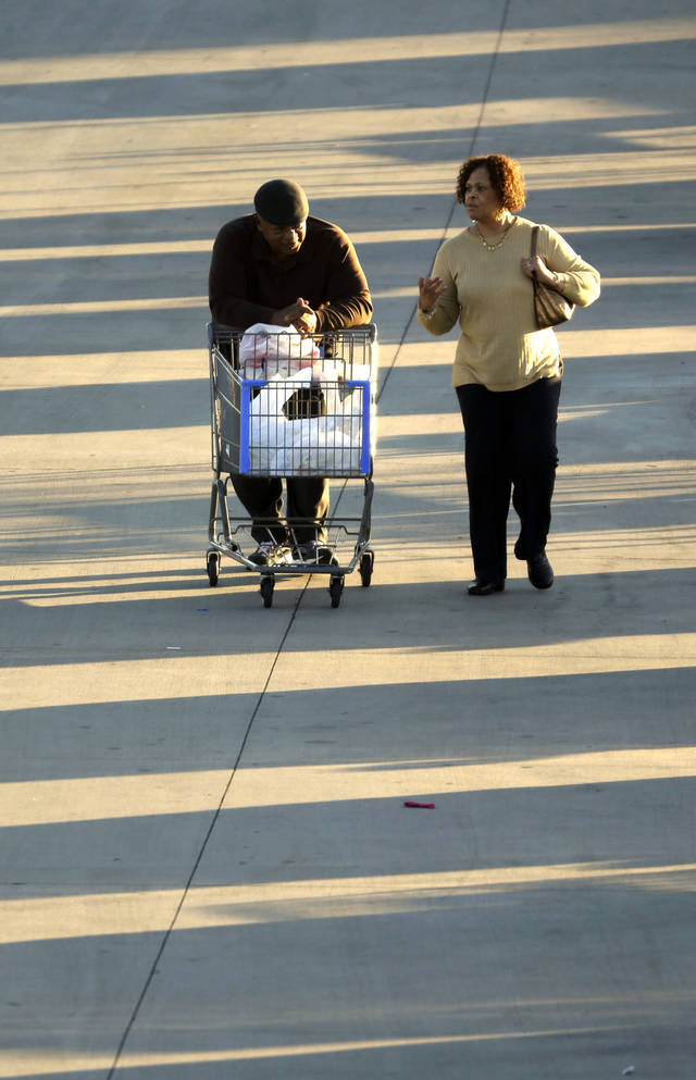 In this Tuesday, Dec. 18, 2012, file photo, shoppers push a cart with merchandise at a Walmart Supercenter store in Little Rock, Ark. U.S. holiday retail sales this year are the weakest since 2008, after a shopping season disrupted by storms and rising uncertainty among consumers.  A report out Tuesday, Dec. 25, 2012, that tracks spending, called MasterCard Advisors SpendingPulse, says holiday sales increased 0.7 percent. Analysts had expected sales to grow 3 to 4 percen(AP Photo/Danny Johnston)