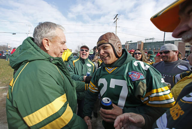Tommy Thompson, republican candidate for U.S. senate and former Gov. of Wis, greets people while tailgating at Lambeau Field before the Green Bay Packers and Arizona Cardinals NFL football game Sunday, Nov. 4, 2012, in Green Bay, Wis. (AP Photo/Jeffrey Phelps)