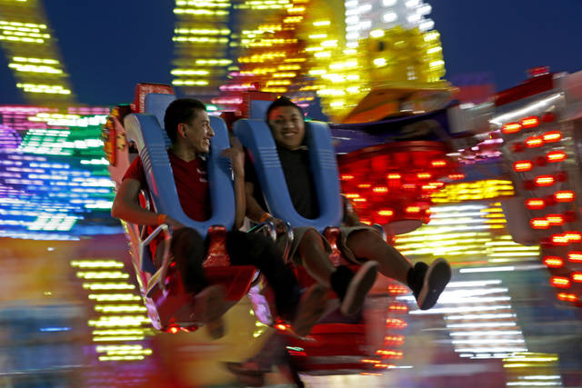 Patrons to the Oklahoma State Fair go for a spin on a ride after sunset at the Oklahoma State Fair in Oklahoma City, Wednesday, September 19, 2012. Photo by Bryan Terry, The Oklahoman