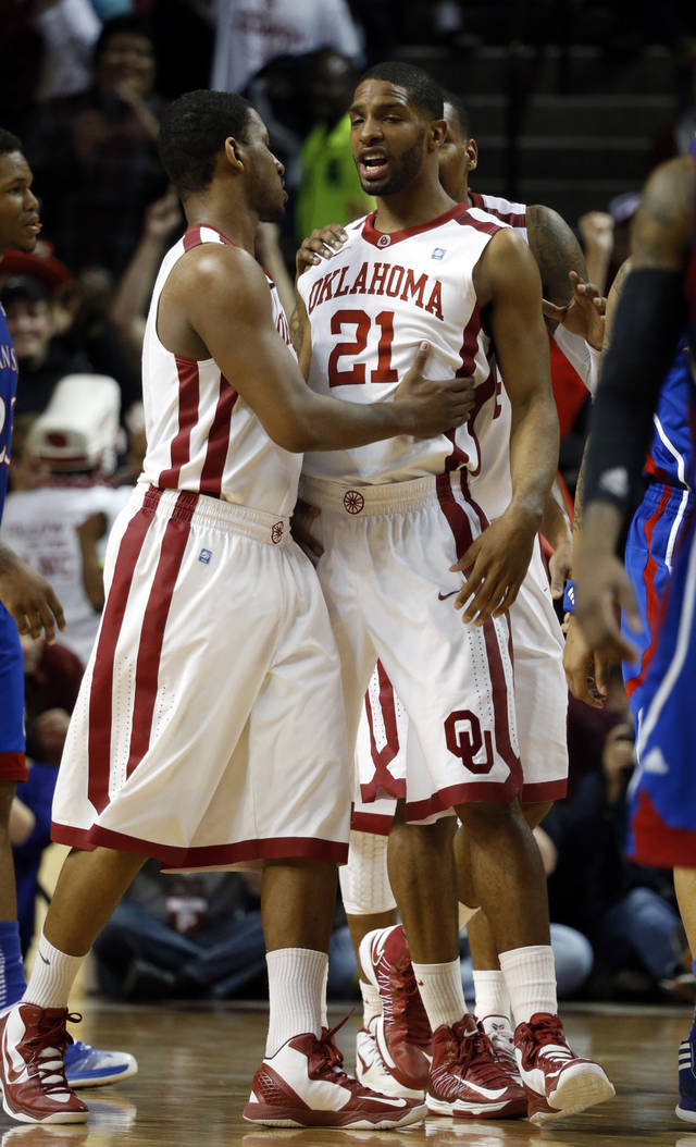 Oklahoma's Steven Pledger, left, and Cameron Clark (21) share a moment during the second half as the University of Oklahoma Sooners (OU) defeat the Kansas Jayhawks (KU) 72-66 in NCAA, men's college basketball at The Lloyd Noble Center on Saturday, Feb. 9, 2013 in Norman, Okla. Photo by Steve Sisney, The Oklahoman