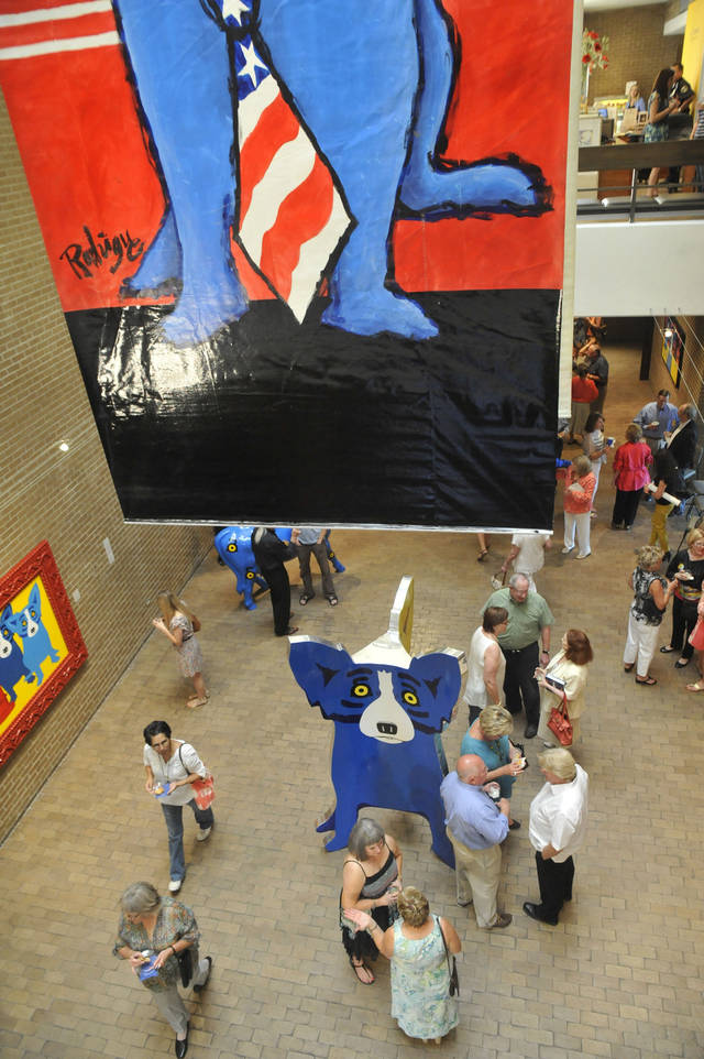 ?Rodrigue: Blue Dogs in Texas? features more than 110 works by the Louisiana artist George Rodigue. PHOTO BY ELAINE WARNER, FOR THE OKLAHOMAN.. <strong></strong>