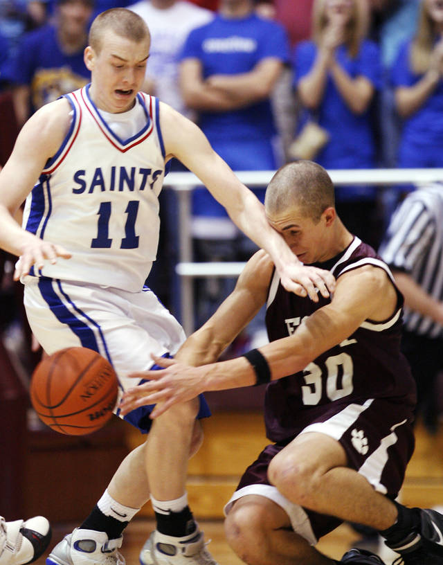 Oklahoma Christian's Nick Johnson (11) and Foyil's Jason Kersey (30) chase a loose ball during the 2A High School State Basketball Tournament at Southern Nazarene University in Bethany, Okla., Friday, March 9, 2007. By James Plumlee, The Oklahoman