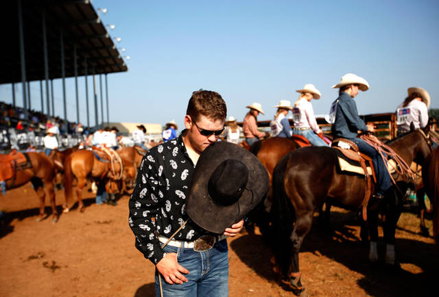 Trenton Turner of Springfield, Col., prays before day four of the International Finals Youth Rodeo at the Shawnee Expo Center in Shawnee, Okla, Wednesday, July 11, 2012. Photo by Sarah Phipps, The Oklahoman