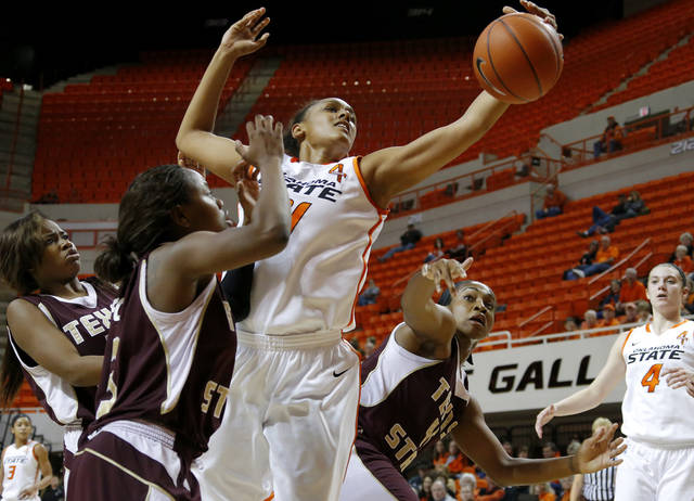 Oklahoma State's Kendra Suttles (31) goes for the ball between Texas State's Erin Peoples, left, Diamond Ford, and Ashley Ezeh during a women's college basketball game between Oklahoma State University and Texas State at Gallagher-Iba Arena in Stillwater, Okla., Wednesday, Nov. 28, 2012.  Photo by Bryan Terry, The Oklahoman