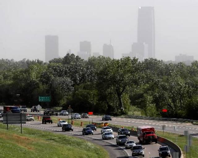 Traffic flows along Broadway Extension as winds from a cold front make the downtown skyline hard to see in Oklahoma City, Friday, September, 7, 2012. Photo by Bryan Terry