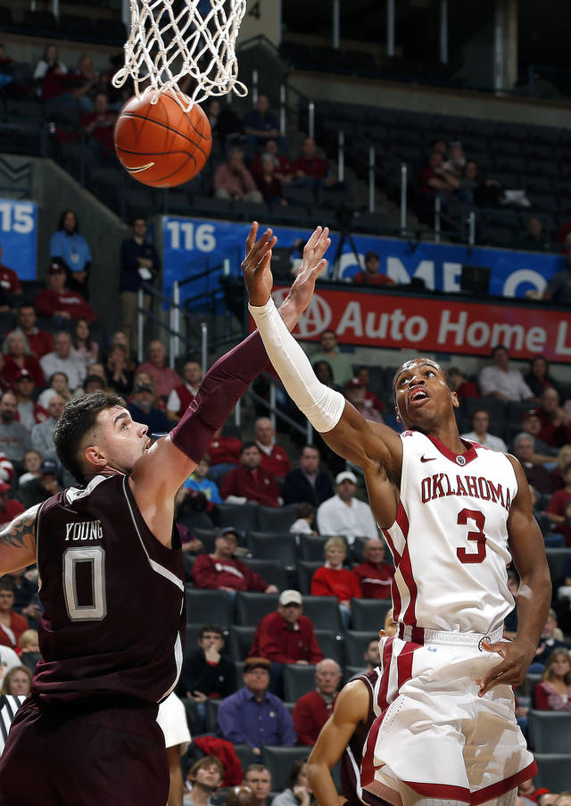 Oklahoma's Buddy Hield (3) shoots a lay up as Texas A&M's Andrew Young (0) defends during the All College Classic between the University of Oklahoma and Texas A&M at the  Chesapeake Energy in  Oklahoma City, Saturday,Dec. 15, 2012. Photo by Sarah Phipps, The Oklahoman