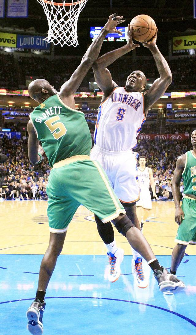 Oklahoma City's Kendrick Perkins, right, shoots over Boston's Kevin Garnett during Sunday's game.  Photo by Sarah Phipps, The Oklahoman