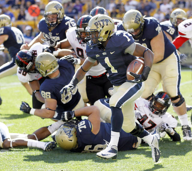 Pittsburgh running back Ray Graham (1) runs past Gardner-Webb linebacker Bradley Taylor (47) in the first quarter of an NCAA college football game on Saturday, Sept. 22, 2012, in Pittsburgh. (AP Photo/Keith Srakocic)