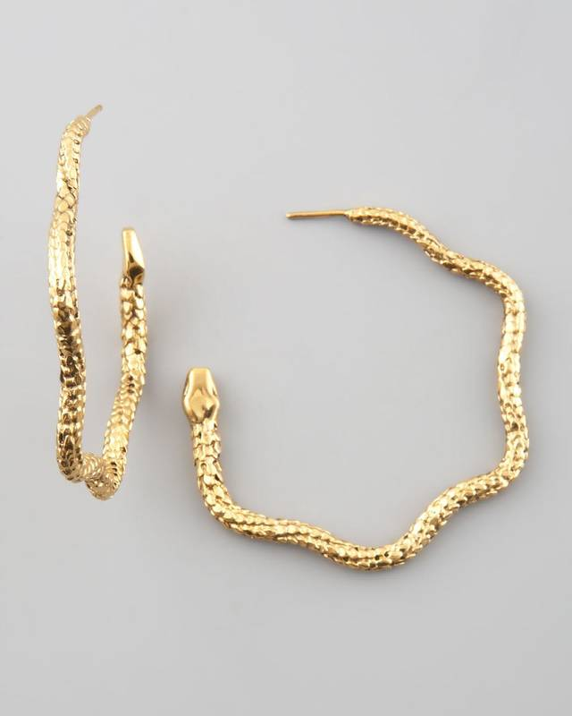 For those who follow the Chinese zodiac, the year of the snake begins Feb. 10. Some ways to incorporate the symbol of the year into your wardrobe, with no harm done to any living creature include these Aurelie Bidermann snake hoop earrings, $335 from NeimanMarcus.com. (NeimanMarcus.com via Los Angeles Times/MCT)