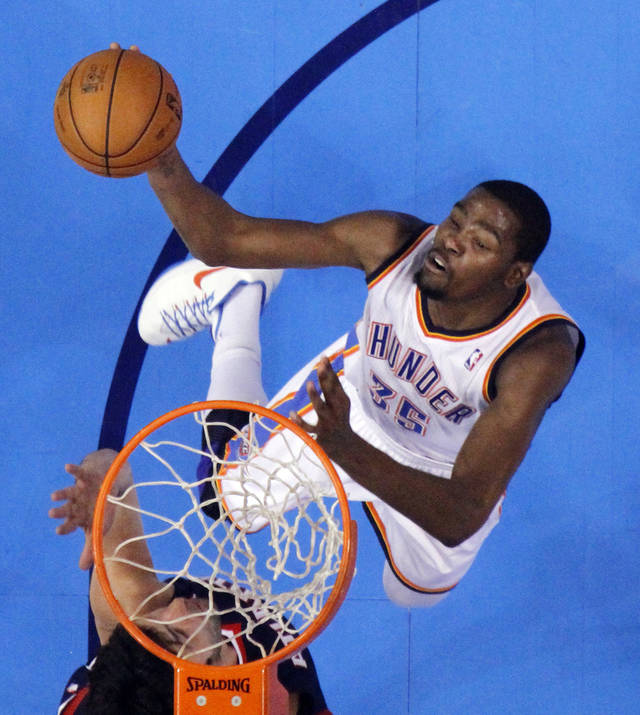 Oklahoma City Thunder's Kevin Durant (35) shoots as the Atlanta Hawks defeat the Oklahoma City Thunder 104-95 in NBA basketball at the Chesapeake Energy Arena in Oklahoma City, on Sunday, Nov. 4, 2012.  Photo by Steve Sisney, The Oklahoman