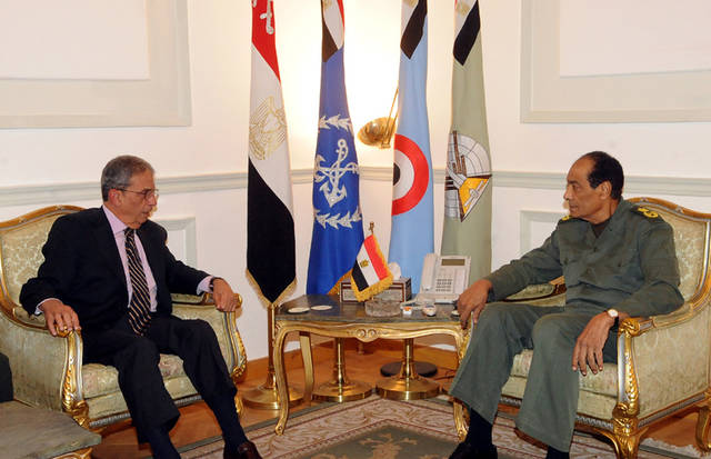 FILE - In this Saturday, Nov. 26, 2011 file photo provided by the Egyptian state news agency MEAN, presidential hopeful Amr Moussa, left, meets with Field Marshal Hussein Tantawi, right, in Cairo. In the race to become the first president of the new Egypt, the secular candidate with the strongest chance of beating increasingly powerful Islamists has to overcome the baggage he brings from the old Egypt. On the campaign trail ahead of next month's landmark vote, the 76-year-old Amr Moussa presents himself as an elder statesman with years of experience in politics and government, first from a decade as foreign minister under former President Hosni Mubarak, then from another decade leading the Arab League.(AP Photo/Middle East News Agency, File)