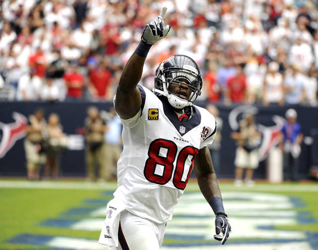 FILE - In this Sept. 9, 2012, file photo, Houston Texans wide receiver Andre Johnson (80) celebrates a touchdown catch against the Miami Dolphins in the second quarter of an NFL football game in Houston. Johnson doesn't like to dwell on the past. Still, Houston's star receiver sometimes has to tell his teammates how lucky they are to be on one of the best teams in the NFL. For years he languished on terrible Texans teams.  (AP Photo/Dave Einsel, File)