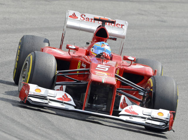 Championship leader Ferrari driver Fernando Alonso of Spain speeds during a training session at the German Formula One Grand Prix in Hockenheim, Germany, Saturday, July 21, 2012. The German Grand Prix will be held Sunday, July 22, 2012. (AP Photo/Jens Meyer)