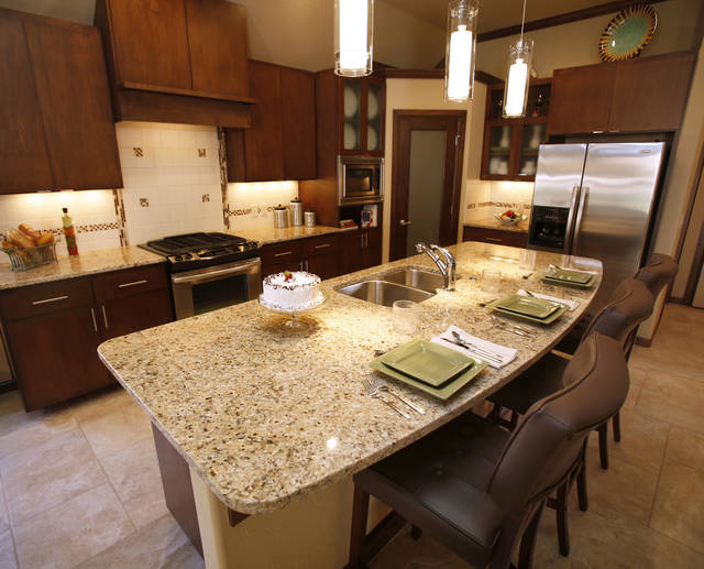 The center island is more than a work island in the kitchen at 3125 SW 136 Terrace. It has a sink, but also plenty of space for seating.