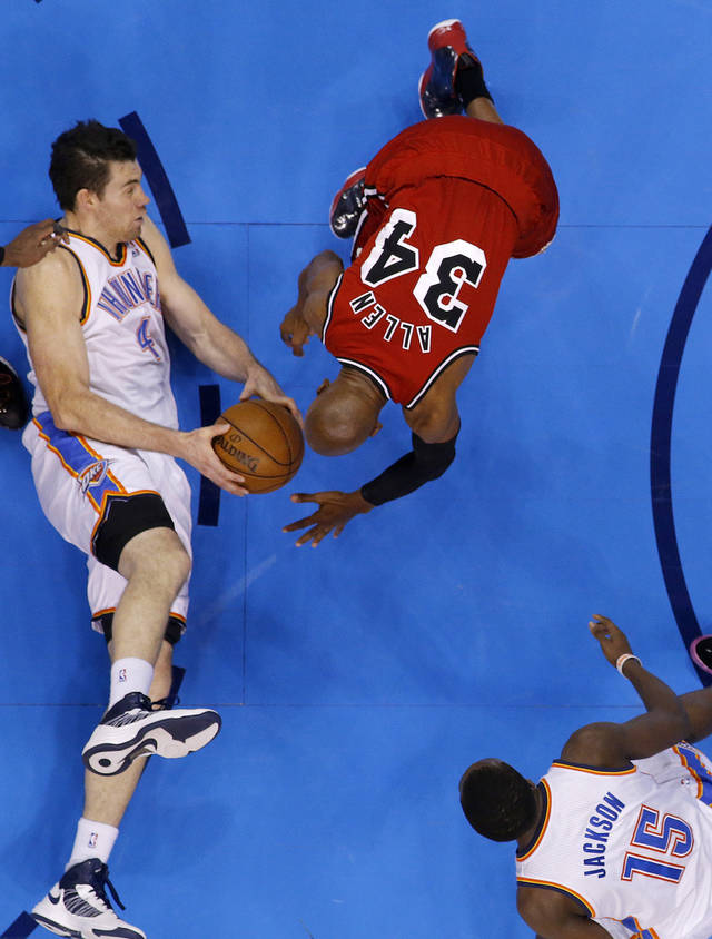 Oklahoma City's Nick Collison (4) looks to pass the ball past Miami's Ray Allen (34) during an NBA basketball game between the Oklahoma City Thunder and the Miami Heat at Chesapeake Energy Arena in Oklahoma City, Thursday, Feb. 15, 2013. Miami won 110-100. Photo by Bryan Terry, The Oklahoman