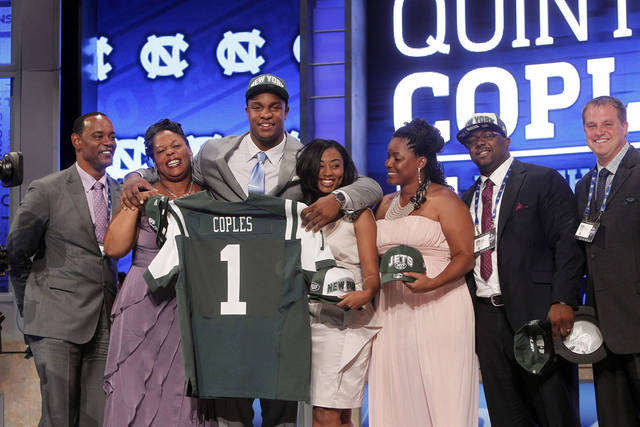 North Carolina defensive end Quinton Coples poses for photographs with loved ones after being selected as the 16th pick overall by the New York Jets in the first round of the NFL football draft at Radio City Music Hall, Thursday, April 26, 2012, in New York. (AP Photo/Jason DeCrow)
