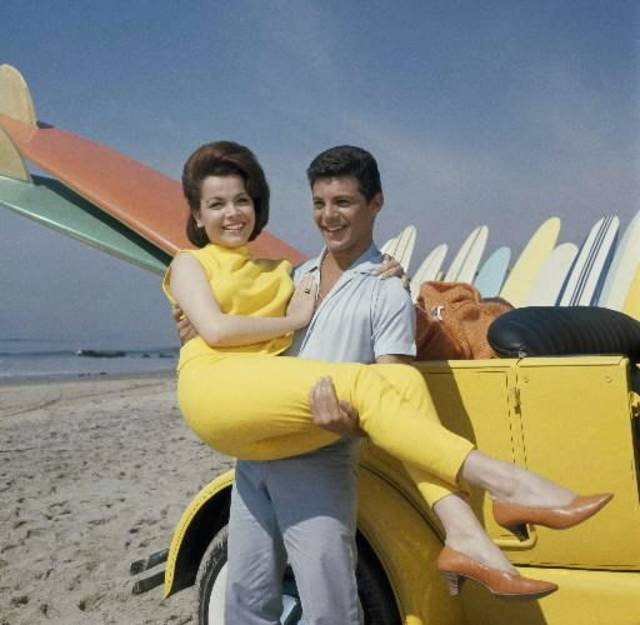 "In this 1963 file photo, singer Frankie Avalon and actress Annette Funicello are seen on Malibu Beach during filming of ""Beauty Party,"" in California in 1963. Walt Disney Co. says, Monday, April 8, 2013, that former ""Mouseketeer"" Funicello, also known for her beach movies with Avalon, has died at age 70. (AP)"