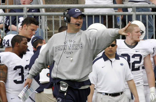 FILE - In this April 21, 2012, file photo, Penn State football coach Bill O'Brien gestures during the NCAA college football team's spring scrimmage in State College, Pa. After seven wrenching months of utter turmoil, shock and sadness, Penn State is looking toward the future and trying to change the subject by focusing on their Sept. 1 season opener at 107,000-seat Beaver Stadium against Ohio. (AP Photo/Keith Srakocic, File)