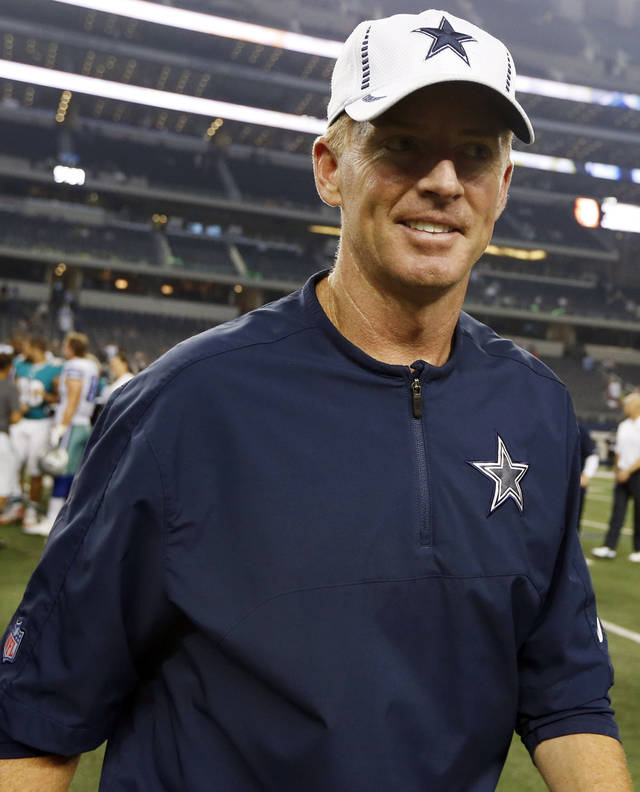 Dallas Cowboys head coach Jason Garrett leaves the field after a preseason NFL football game against the Miami Dolphins, Wednesday, Aug. 29, 2012, in Arlington, Texas. The Cowboys won 30-13. (AP Photo/Sharon Ellman)