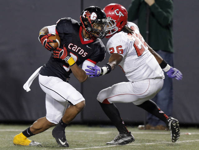 East Central's Deontre Youngblood (3) runs past Carl Albert's Dillon Lohr (26) during the Class 5A Oklahoma state championship football game between Carl Albert High School and Tulsa East Central High School at Boone Pickens Stadium on Saturday, Dec. 1, 2012, in Stillwater, Okla.   Photo by Chris Landsberger, The Oklahoman