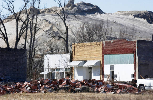 On Picher's Main Street, the bricks in the foreground are the remains of the former Lion Supply that had closed. It burned down a few weeks ago.  Photo by Gary Crow, For the Tulsa World