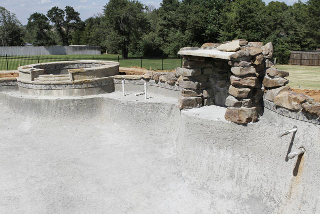A swimming pool by Lifestyle Pools LLC is unfinished at a home in southeast Oklahoma City in this photo from last July. The company had been in trouble with the Oklahoma Tax Commission for back taxes and had gotten behind or failed to finish work. The owner pleaded guilty Friday in federal court to failing to forward payroll withholding taxes to the Internal Revenue Service. <strong>Steve Gooch - The Oklahoman</strong>