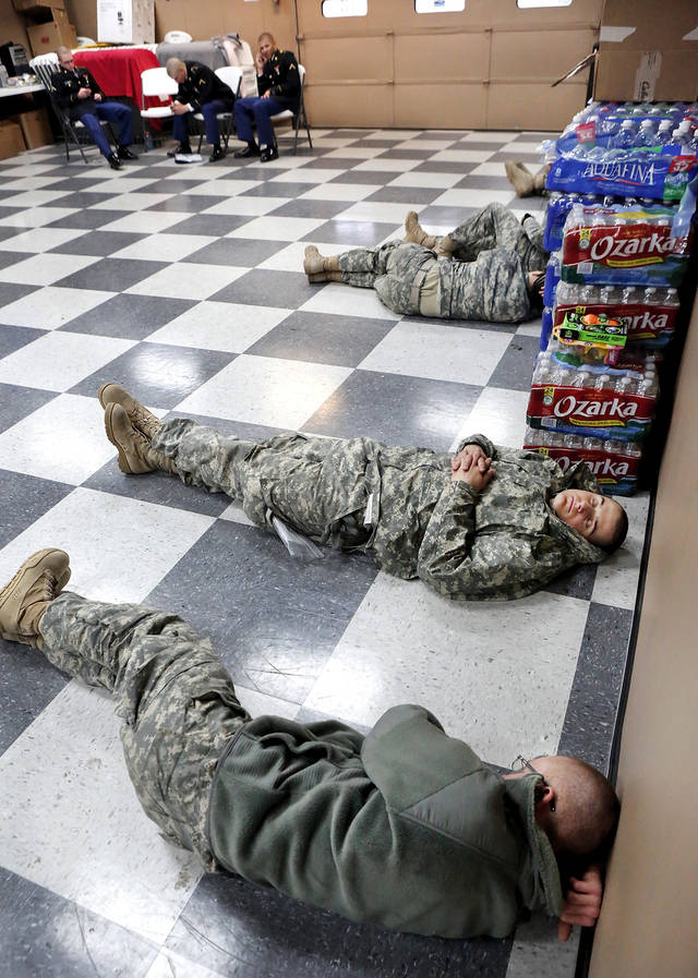 Soldiers line up against a wall, taking naps in the welcome center, waiting for their flights to arrive. Nearly 700 soldiers from Ft. Sill, most of whom had recently completed their basic training,  arrived at Will Rogers World Airport on buses in pre-dawn hours Thursday,  Dec. 20, 2012, to catch flights to join join their families for the Christmas holidays.  The troops were welcomed by Blue Star Mothers and other volunteers at the YMCA Military Welcome Center, where they were offered pizzas, doughnuts,  chips, sub sandwiches, desserts, hot coffee and cold beverages. Local merchants donated 250 pizzas, 60 dozen doughnuts and the submarine sandwiches.   Photo by Jim Beckel, The Oklahoman
