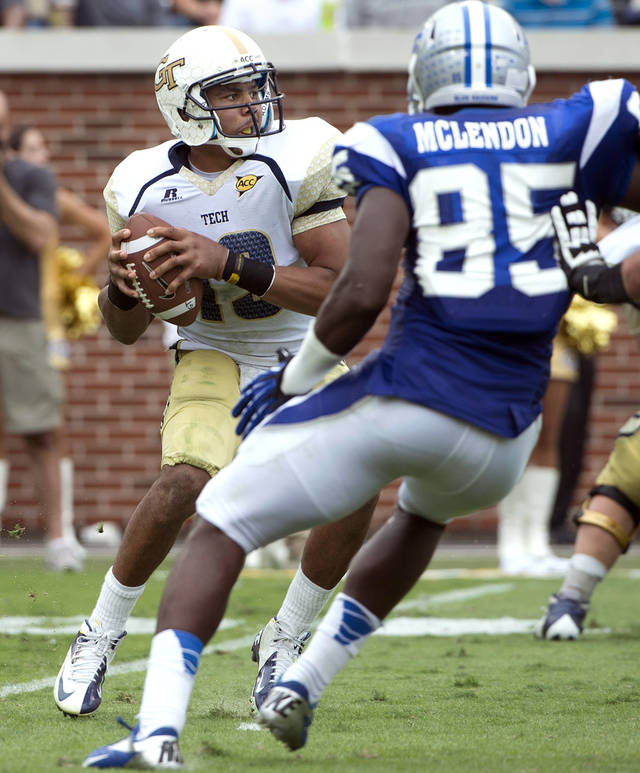 Georgia Tech quarterback Tevin Washington drops back for a pass against Middle Tennessee State defenders in the second half of an NCAA college football game on Saturday, Sept. 29, 2012, in Atlanta. (AP Photo/Rich Addicks)