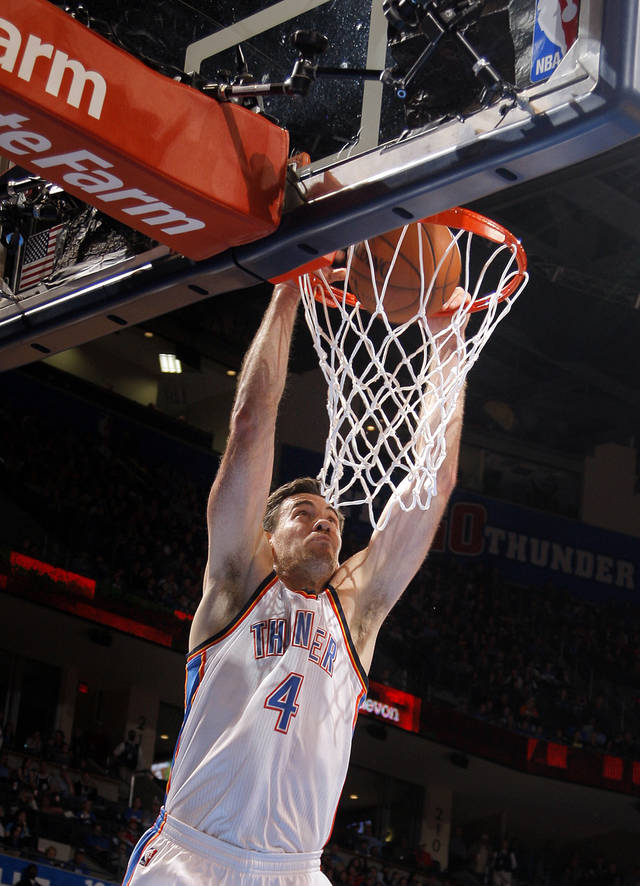 Nick Collison (4) dunks during the NBA basketball game between the Oklahoma City Thunder and the Cleveland Cavaliers at the Chesapeake Energy Arena, Sunday, Nov. 11, 2012. Photo by Sarah Phipps, The Oklahoman