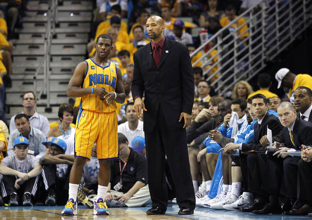 New Orleans Hornets head coach Monty Williams talks with New Orleans Hornets point guard Chris Paul (3) during the second half of game three of a first-round NBA basketball playoff series in New Orleans, Friday, April 22, 2011. The Lakers won 100-86. (AP Photo/Gerald Herbert)