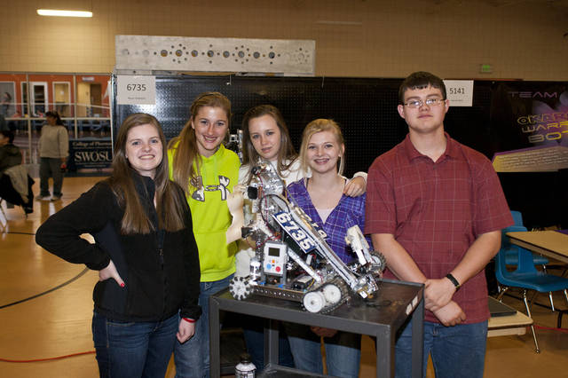 A robotics team from Newcastle competed in the Oklahoma Regional First Tech Challenge at Southwestern Oklahoma State University in Weatherford. From left are Miranda Granger, Makenzie O�Brien, Nadia Moore, Cierra Davis and Collin McAllister. Not pictured is team member Emily McDaniel. PHOTO PROVIDED BY SWOSU