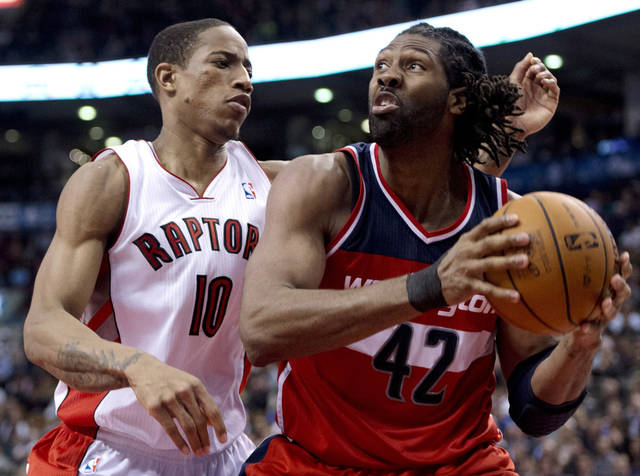 Toronto Raptors guard DeMar DeRozan (10) defends against Washinton Wizards center Nene (42) during the second half of their NBA basketball game, Monday, Feb. 25, 2013, in Toronto. The Wizards won 90-84. (AP Photo/The Canadian Press, Frank Gunn)