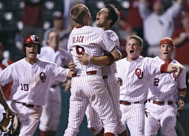 Oklahoma's Tyler Ogle (35) reacts with teammate Danny Black (9) after Ogle's game winning score during the bottom of the ninth inning in the Sooners' 3-2 win in the fourth game of the Big 12 Baseball Championship between Oklahoma and Kansas at the Bricktown Ballpark on Wednesday, May 26, 2010, in Oklahoma City, Okla.  Photo by Chris Landsberger, The Oklahoman