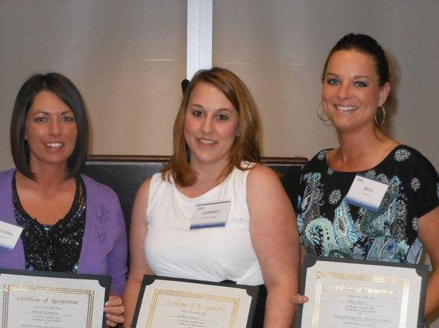 Executive Women International scholarship recipients Shaundra Barnett, Lindsey McGirt and Rita Estes.  Photos PROVIDED