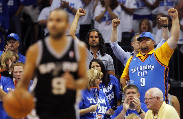 Fans cheer after a Thunder score as San Antonio's Tony Parker (9) dribbles during Game 4 of the Western Conference Finals between the Oklahoma City Thunder and the San Antonio Spurs in the NBA playoffs at the Chesapeake Energy Arena in Oklahoma City, Saturday, June 2, 2012.  Photo by Nate Billings, The Oklahoman