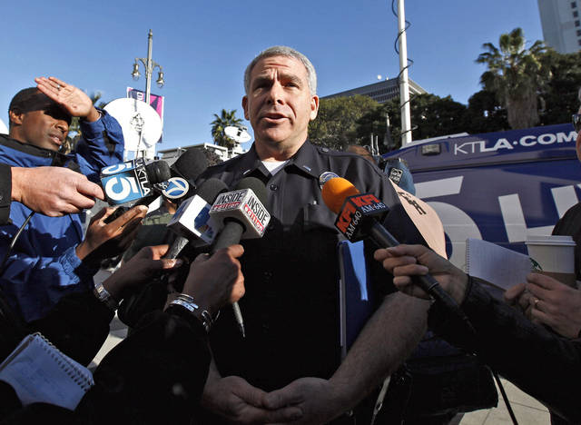 LAPD spokesman Lt.  Andrew Newman talks to reporters at a news conference in Los Angeles, Tuesday, Feb. 12, 2013. Police are now investigating more than 1,000 tips from the public in the search for Christopher Dorner, suspected of a deadly revenge plot against the Los Angeles Police Department.  Neiman said the number of tips has grown from an initial 250 since the city offered a $1 million reward for information leading to the capture of Dorner. (AP Photo/Nick Ut)