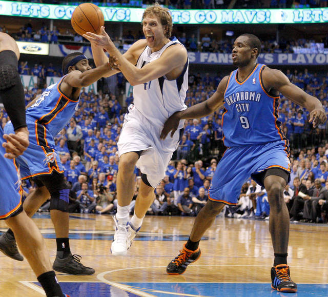 Dirk Nowitzki (41) of Dallas  goes between Oklahoma City's James Harden (13) and Serge Ibaka (9) during game 1 of the Western Conference Finals in the NBA basketball playoffs between the Dallas Mavericks and the Oklahoma City Thunder at American Airlines Center in Dallas, Tuesday, May 17, 2011. Photo by Bryan Terry, The Oklahoman