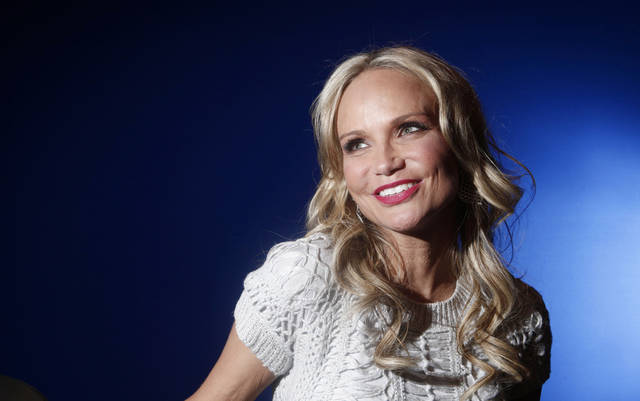 "In this Feb. 28, 2012 photo, actress Kristin Chenoweth poses for a portrait while promoting her ABC show ""GCB,"" in New York.  (AP Photo/Carlo Allegri)"