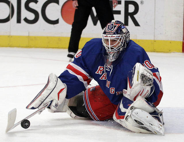 New York Rangers goalie Henrik Lundqvist, of Sweden, stops a shot on the goal during the first period of Game 1 in the second round of the NHL hockey Stanley Cup playoffs against the Washington Capitals Saturday, April 28, 2012, in New York. (AP Photo/Frank Franklin II)