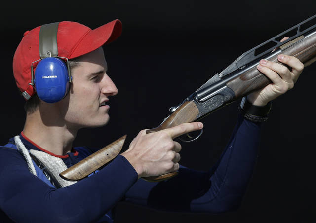 Great Britain's Peter Wilson shoots during qualifiers for the men's double trap event, at the 2012 Summer Olympics, Thursday, Aug. 2, 2012, in London. (AP Photo/Rebecca Blackwell)