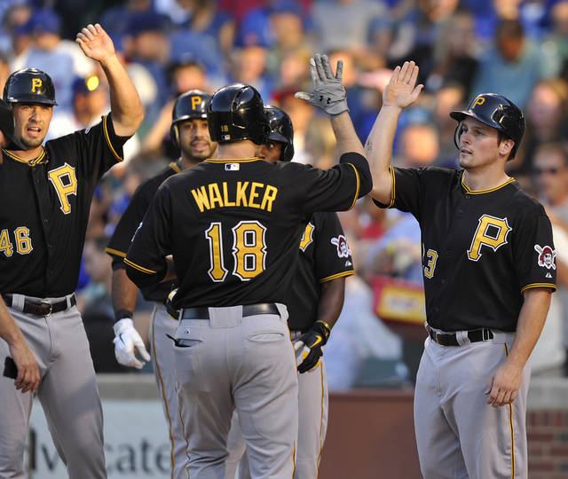 Pittsburgh Pirates' Garrett Jones (46) and Travis Snider right, congratulate Neil Walker (18) after his grand slam against the Chicago Cubs during the first inning of a baseball game Tuesday, July 31, 2012, in Chicago. (AP Photo/Jim Prisching)